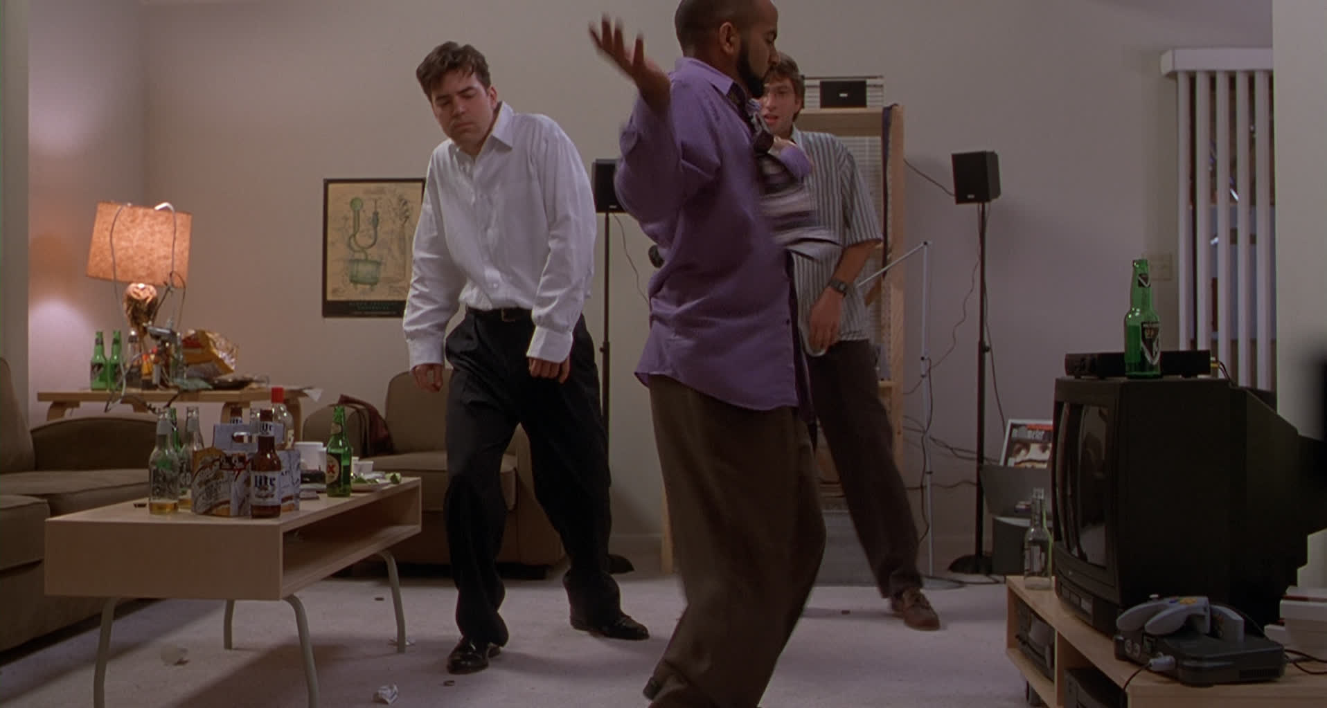 Image of the three programmers from Office Space dancing, with a Nintendo 64 on the right side of the frame